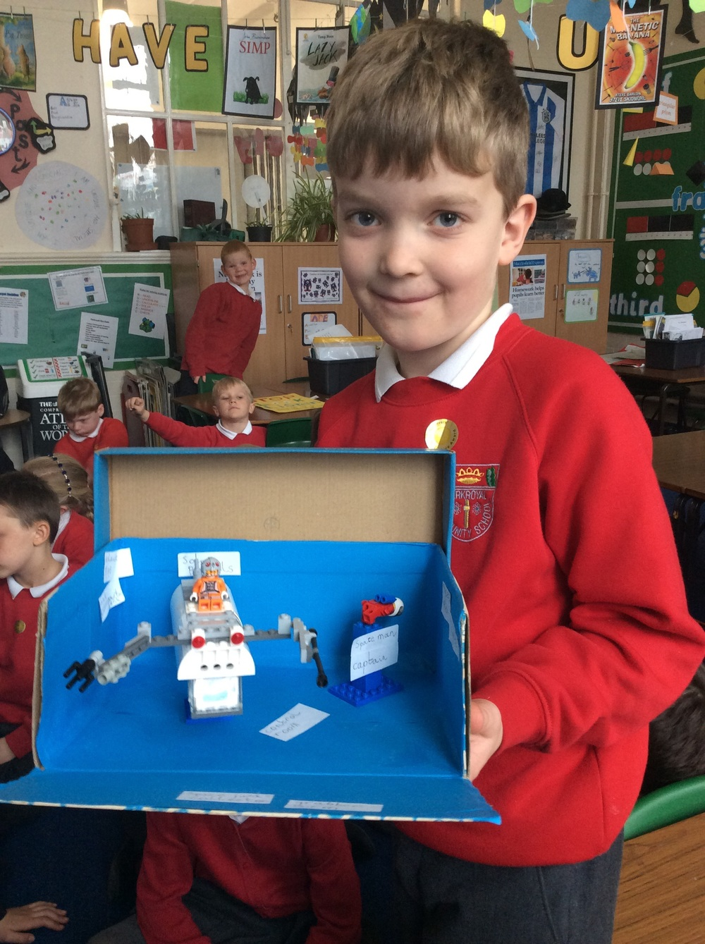 Jake's space vehicle will collect rocket debris with its grabber arm...