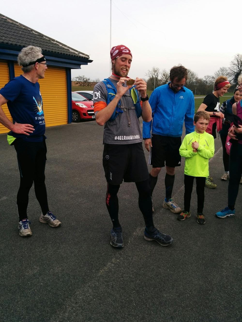Ben accepting his post run medal