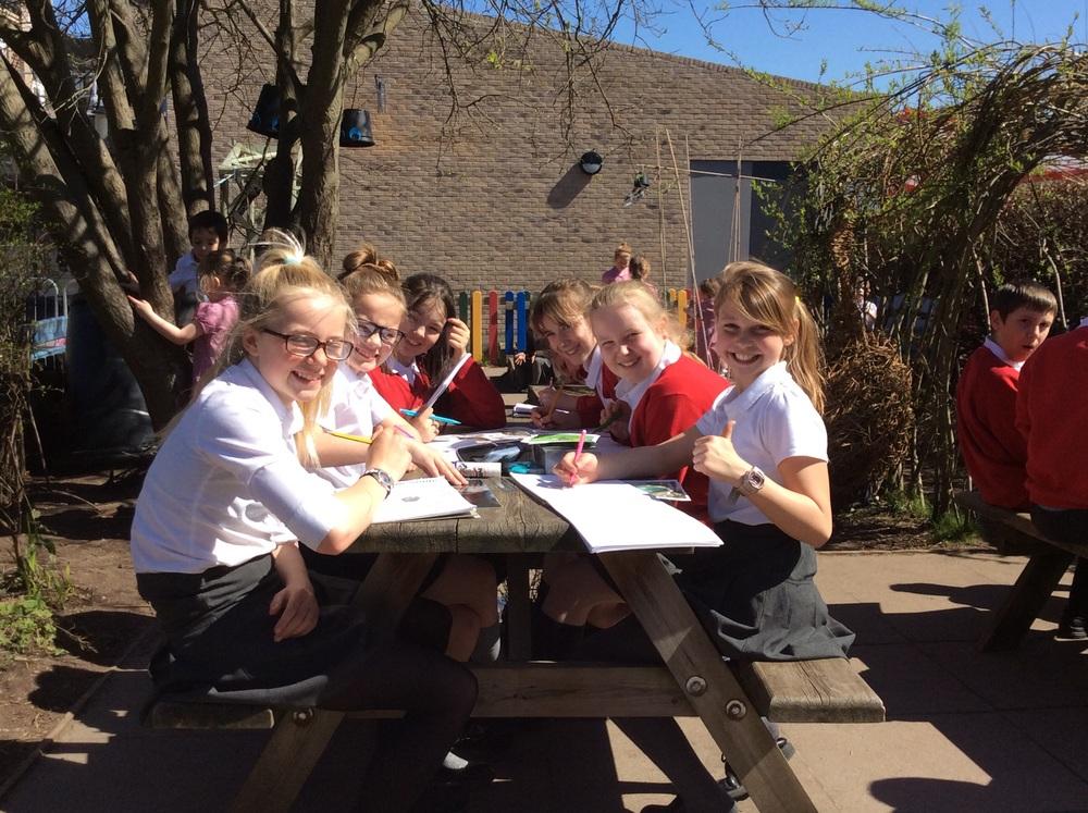 The girls carefully sketching their African animal eyes.