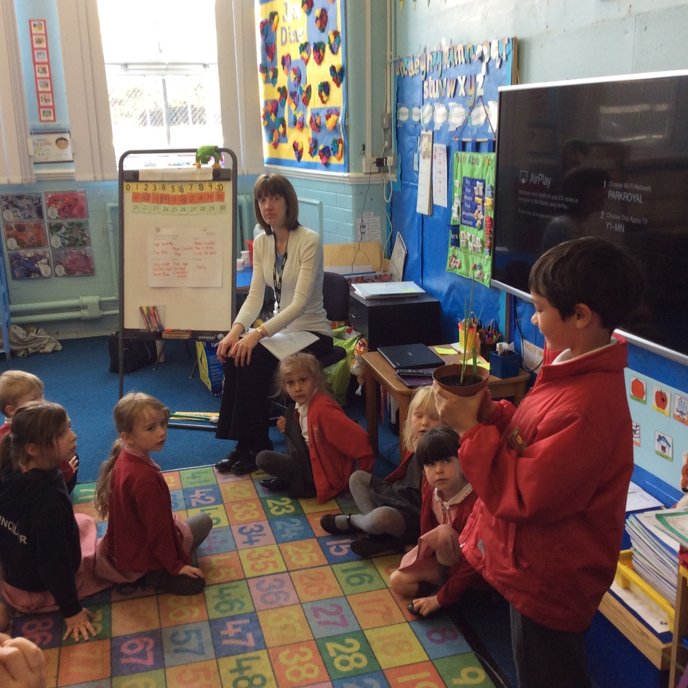 Year 1 listen to instructions about the Onion Games...Miss Naylor looks apprehensive.