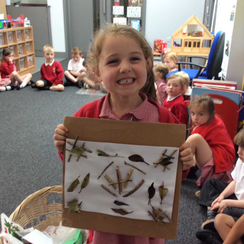 A symmetrical pattern using twigs and leaves.