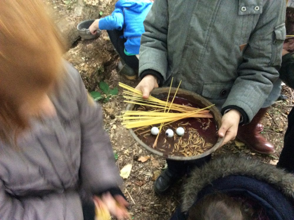 More lunch? Dylan making worm and eyeball spaghetti in the mud kitchen