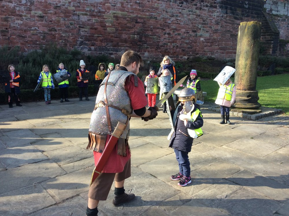 Lola battles a centurion in the Roman gardens whilst the locals watch on from the walls in fascination....