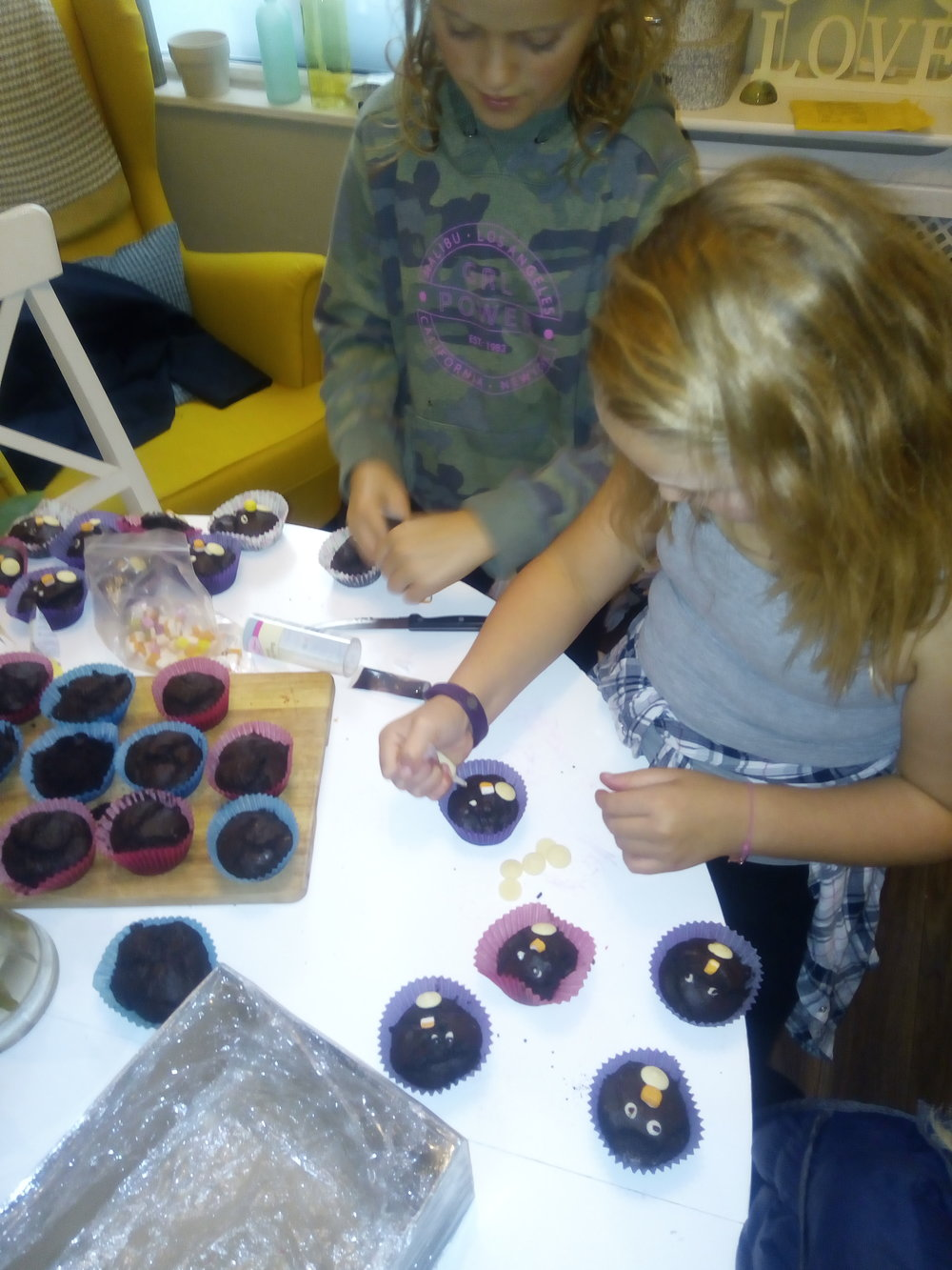 Abbey and Kitty both from 5BJ, busy decorating their chocolate penguin cupcakes.