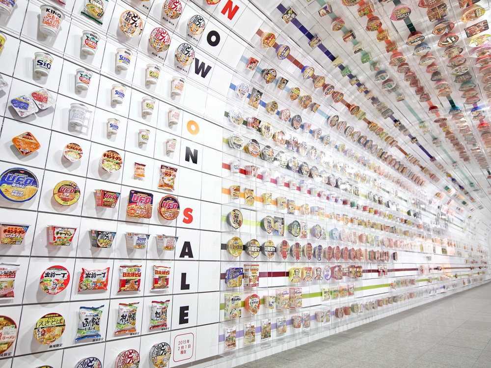 STARTING WITH THE COMPANY'S FIRST CUP NOODLE PACKAGE OF THE CHICKEN RAMEN, YOU MAY GLANCE AT THE 800 DIFFERENT DESIGNS AND TYPES OF CUP NODDLE PACKAGES THAT ARE ORGANIZED WITH PRECISION ACCORDING TO WHEN EACH OF THE PRODUCTS BECAME AVAILABLE FOR PURCHASE.