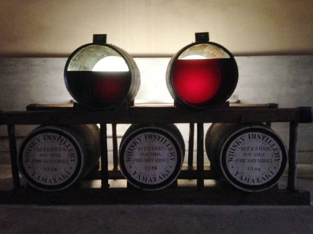 The distillery tour shows how the whiskey inside the barrels, over time, goes through chemical changes from reddish wine-like color (right) to a much darker appearance and concentration (left) as time passes.