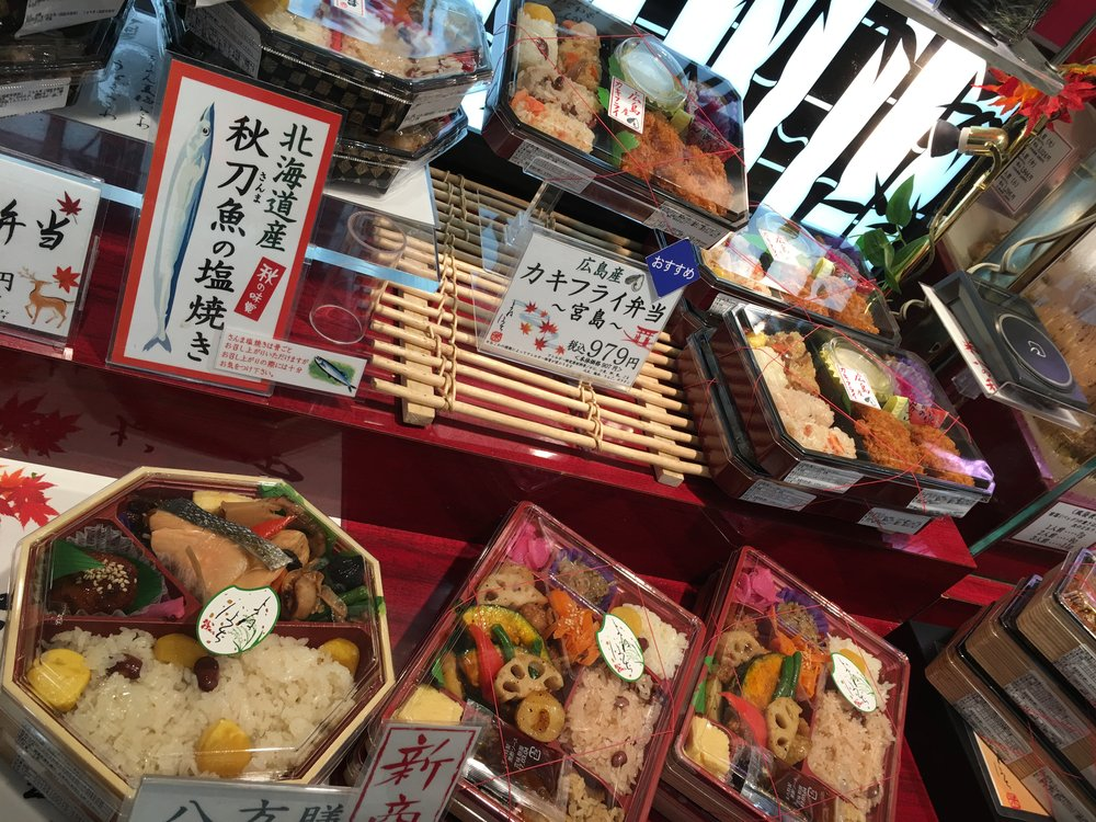 "Ekiben (駅弁) are sold at Japanese train stations and even inside Express trains or ""fast trains""."