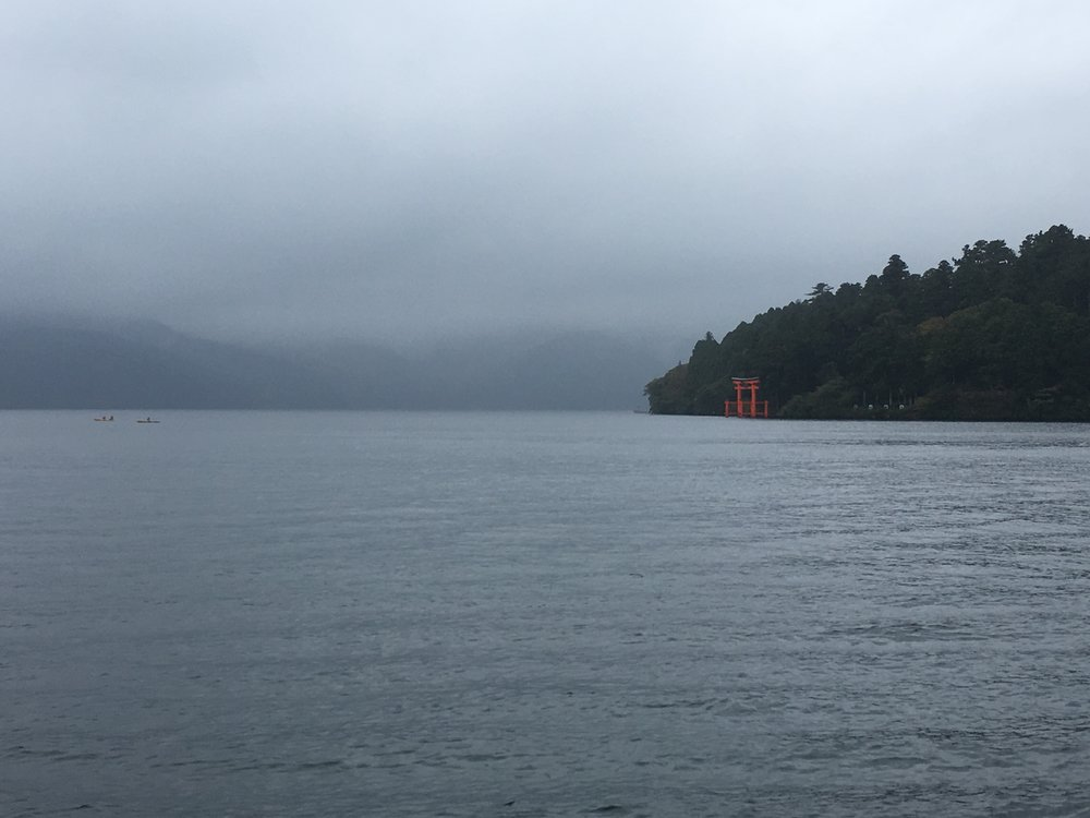 The Hakone Shrine was witnessed across the   lake Ashi  , a crater lake from a volcanic eruption of 1170 CE, on a cooling misty day. This site is popular due to its   view   of Mount Fuji from this very angle on bright sunny days.