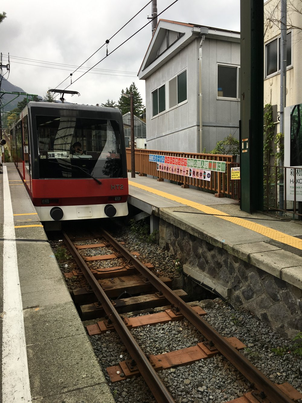 After checking out of Setsugetsuka hotel, I walked a few minutes to Gora Station in order to ride the Hakone Tozan Cable Car. A board sign of Gora Station photo shown   here  .