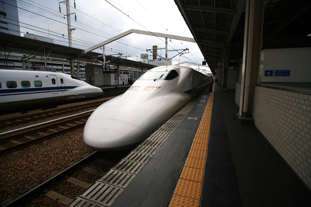 Two Nozomi Shinkansens passing one another at Himeji Station, Hyogyo Prefecture. Photo by: Flickr@LASZLO ILYES