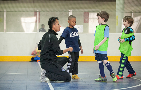 DUSC Coach Junior Villegas teaching campers at DUSC School's Out Camp