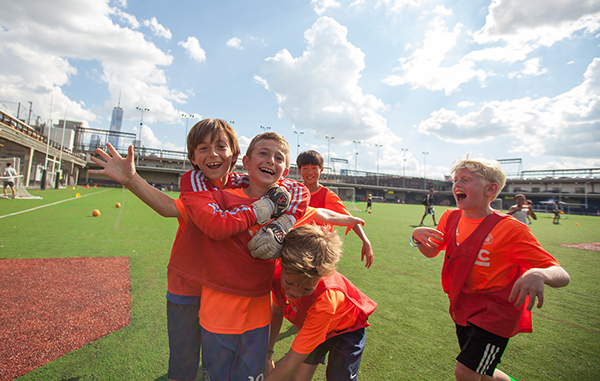 Players celebrating at DUSC Summer Camp.