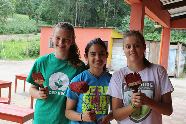 DUSC players visiting Guatemala with Soccer Recycle refurbished furniture.