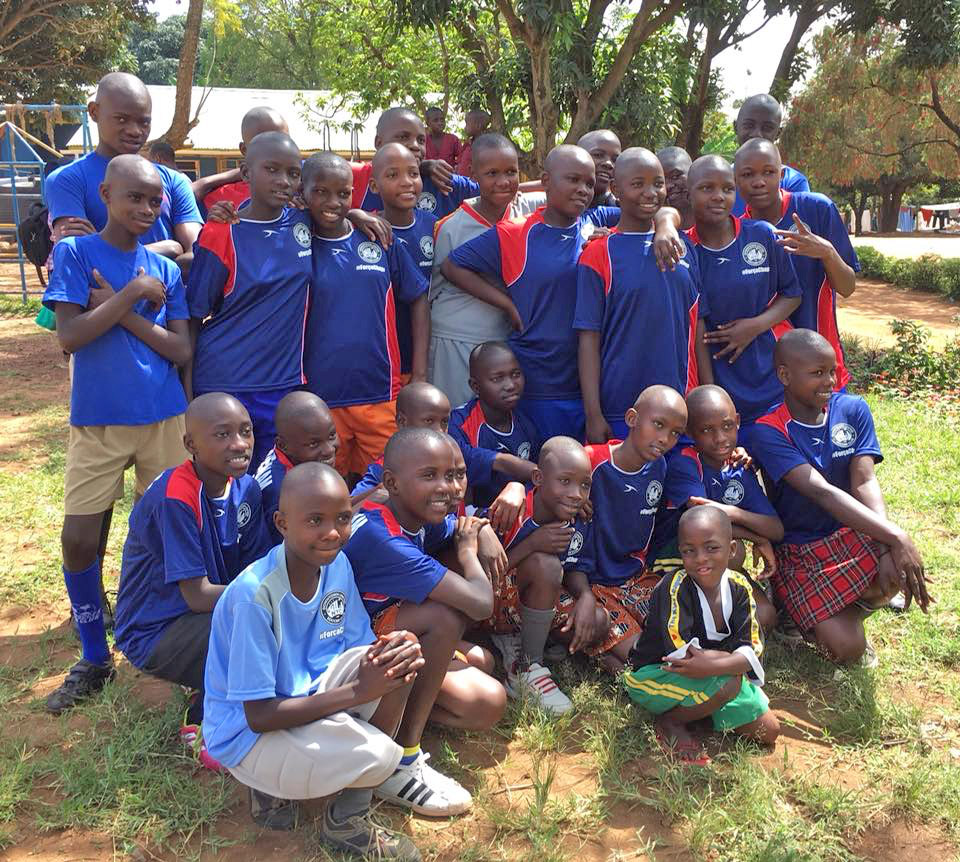 6-12 year old girls from the Mulago School of the Deaf in their new Downtown United Soccer Club jerseys.