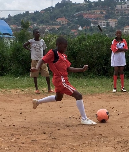 Buguyere Deaf School player takes penalty kick against Ntinda Deaf School in the 2017 G3 Promoting Play Tournament.