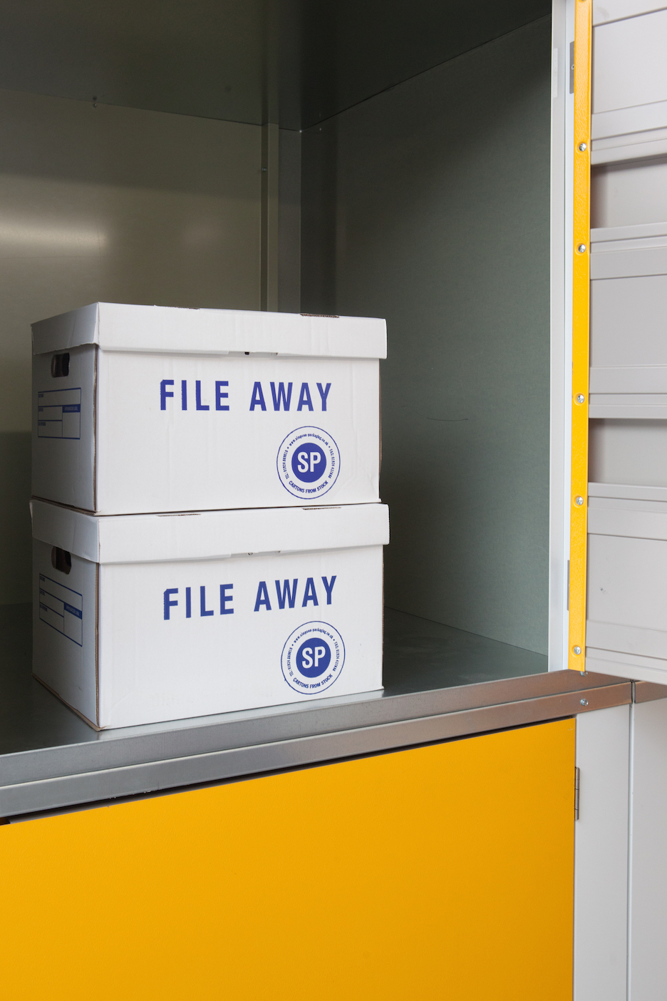 Box files in storage locker at Dartmouth Self Storage