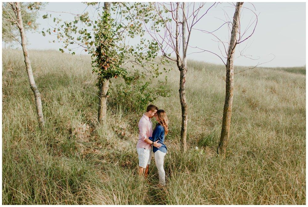 tiscorniabeachpierengagementphotographypuremichiganlakemagicalphoto1.jpg