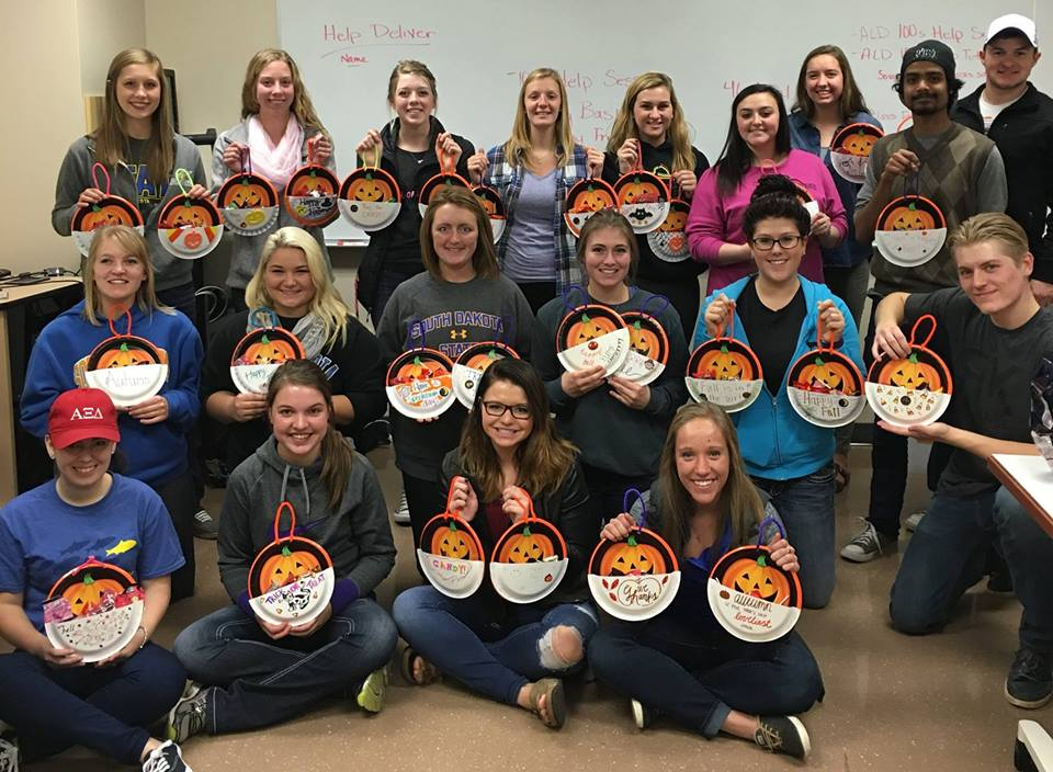 south dakota state university alpha lambda delta members displaying their halloween service projects