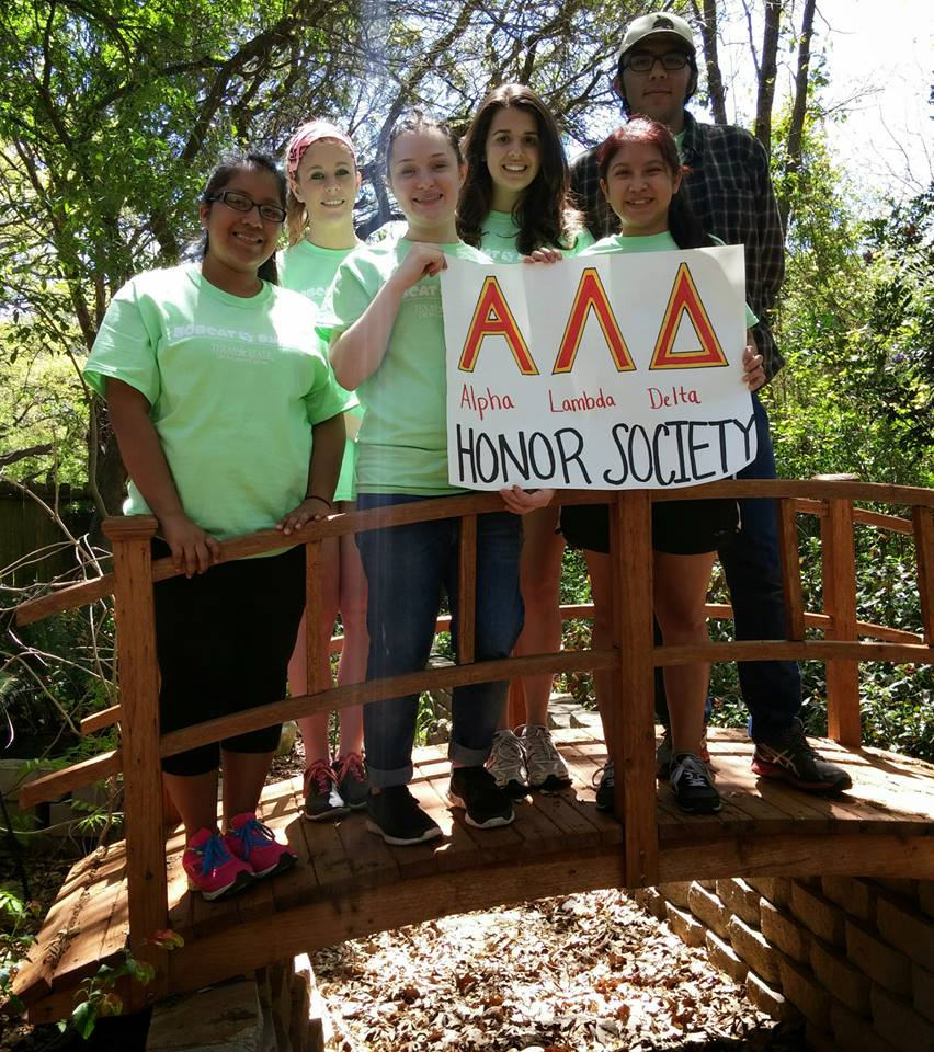 texas state university members representing alpha lambda delta at a community service project