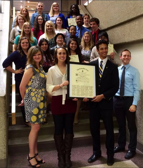 university of wisconsin - milwaukee members holding their original charter