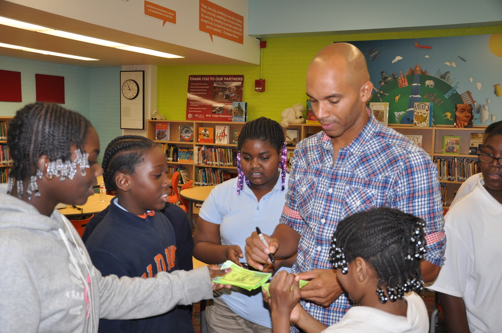 Kadir Nelson_standing and signing autographs.jpg