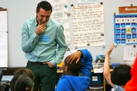 Jarrett Krosoczka engages with a 3rd grader it the Winship School.