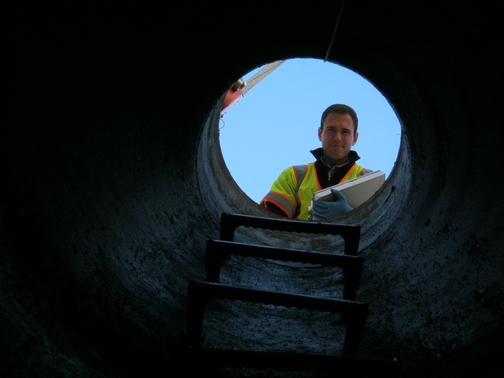 Condition Assessment Andrew looking down manhole.jpg
