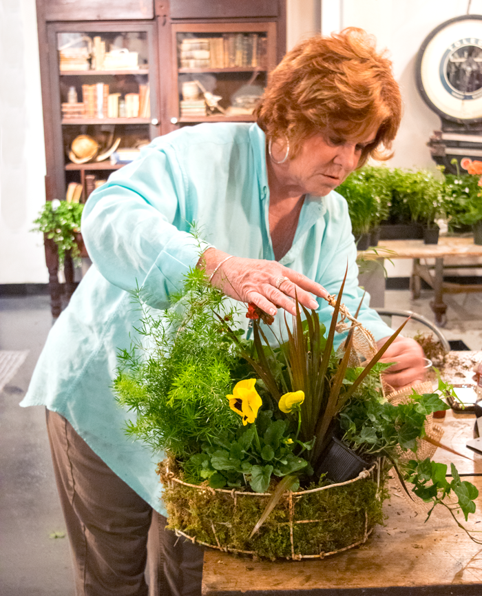 Sandy Doris putting it all together! Love that she selected a vintage folk art basket made from barbed wire!