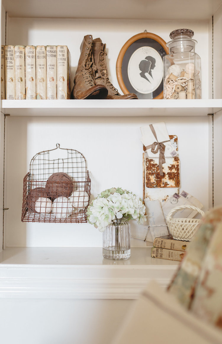 Built in bookcases showcasing antique accessories in the bridal suite at the McConnell house | Interior design : Kim Legget