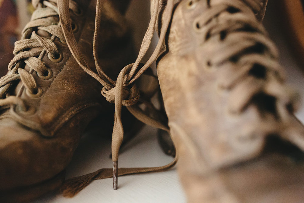 Close up the the old boots in the bridal suite at the McConnell House | Interior design: Kim Leggett, owner of City Farmhouse