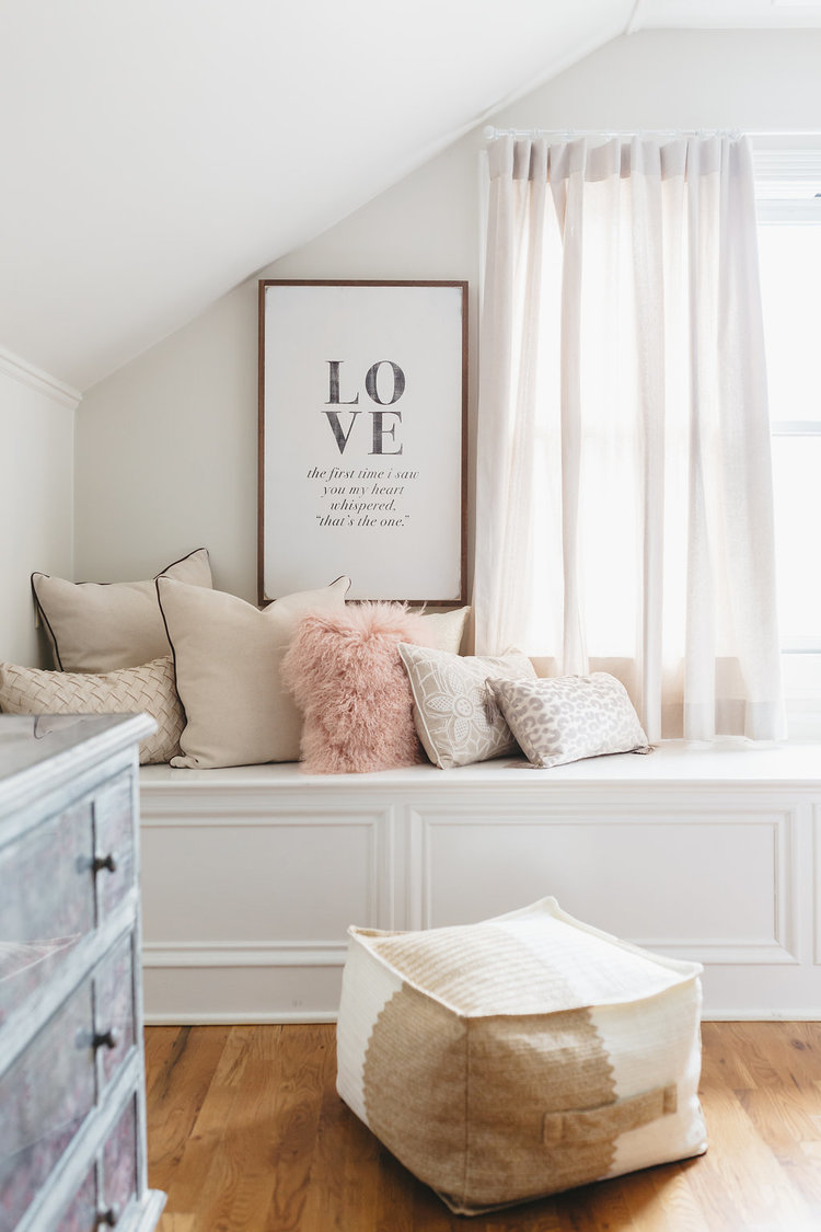 """LOVE"" picture hangs on the wall in the bridal suite at the McConnell house 