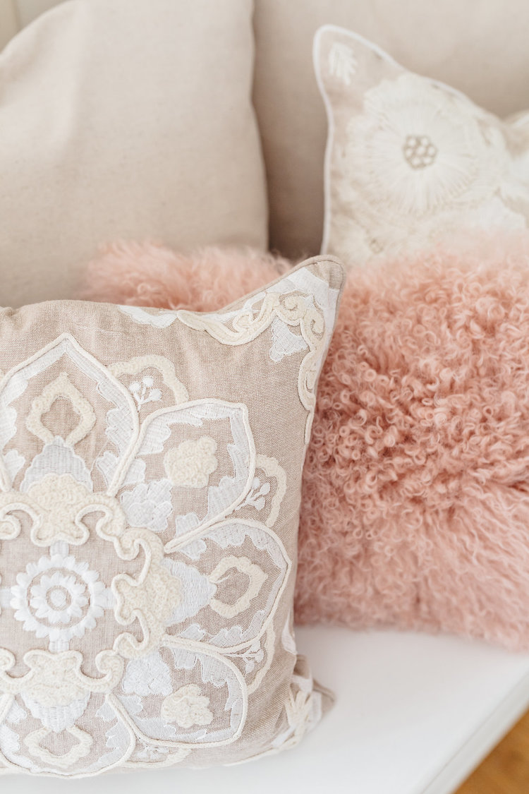 Fun white lacy and pink furry pillows are sprinkled throughout the bridal suite in the McConnell House | Interior design: Kim Leggett, owner of City Farmhouse