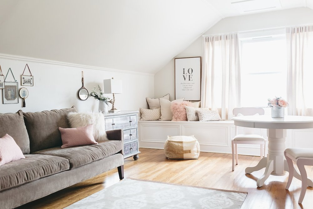 Interior Design: Kim Leggett, City Farmhouse - The McConnell House Bridal Suite in Franklin, TN. A comfortable sofa provides cozy seating in the bridal suite.