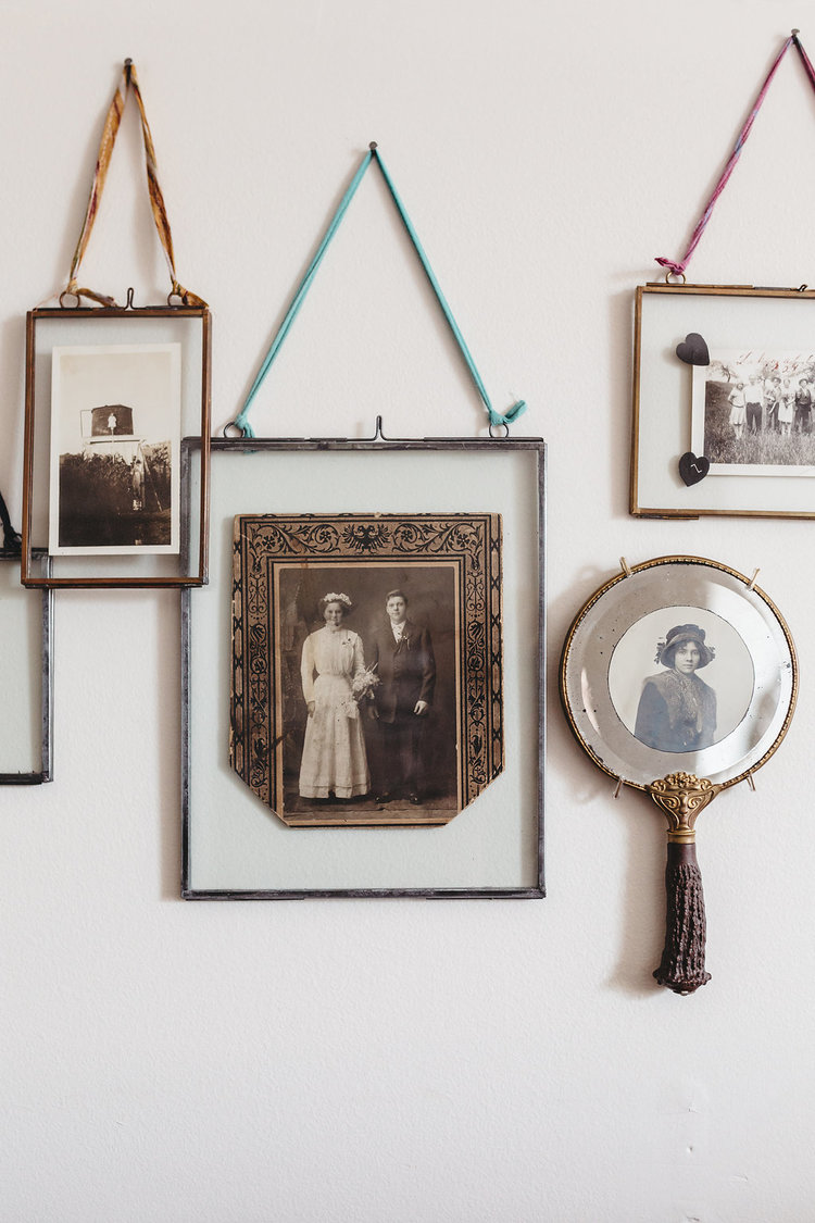 Vintage pictures hang on the walls in the bridal suite at the McConnell House | Interior design: Kim Leggett, owner of City Farmhouse
