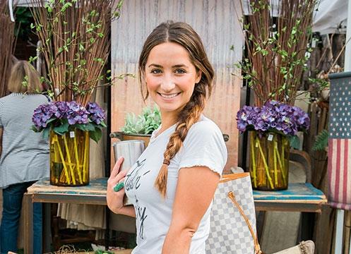 A shopper at the June City Farmhouse Pop Up Fair