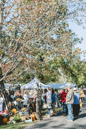 White tents and fall leaves at the City Farmhouse Pop Up Fair