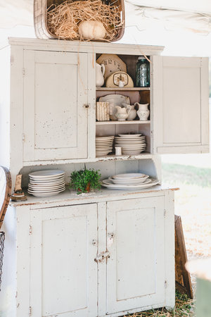 Antique hutch with white chippy paint at the City Farmhouse Pop Up Fair