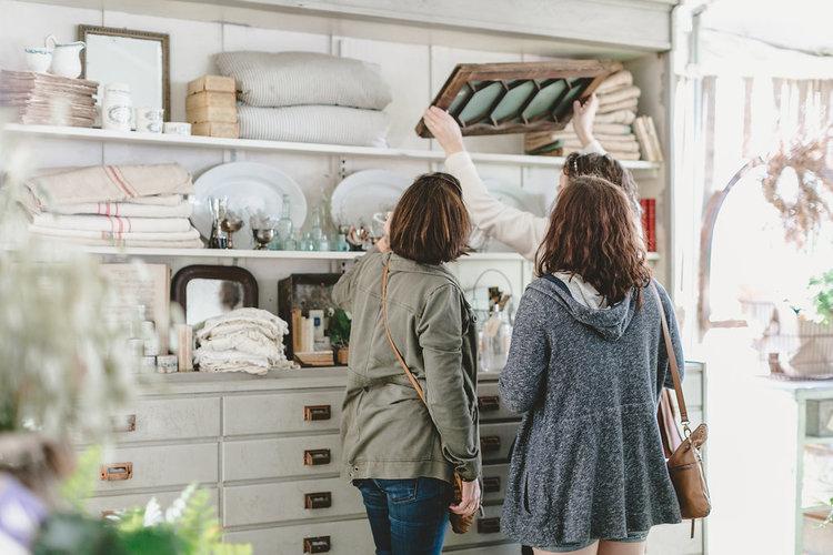 Two women shopping the City Farmhouse Pop Up Fair | Franklin, TN