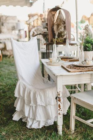 White ruffled slip covered chair at the City Farmhouse Pop Up Fair | Franklin, TN