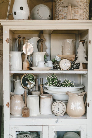 Cabinet full of ironstone pitchers and kitchen scales at the City Farmhouse Pop Up Fair | Franklin, TN