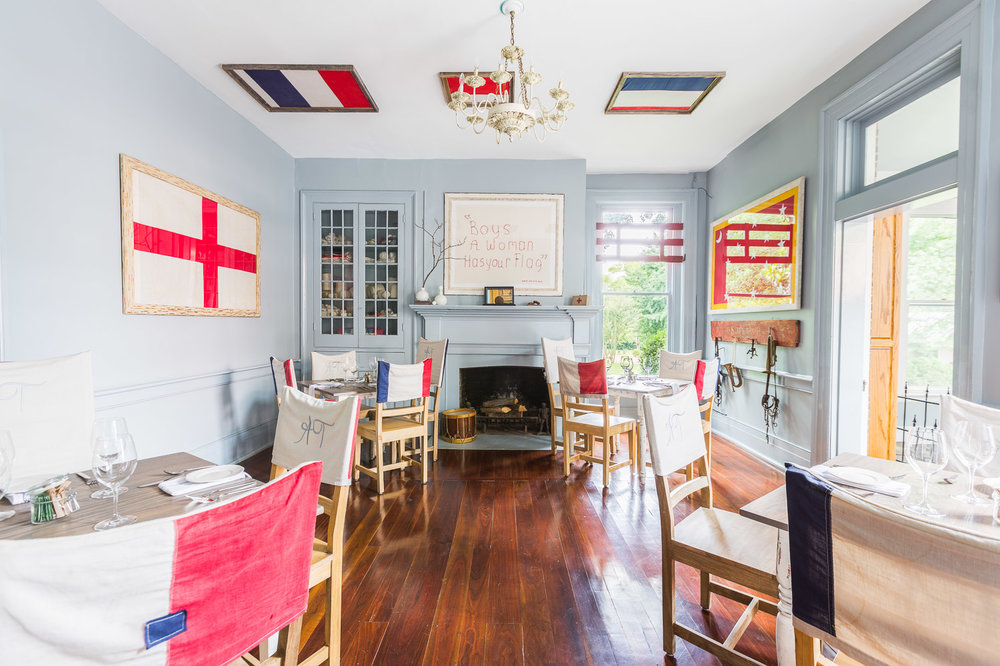 The red cross room in Homestead Manor is filled with blue and red historical pieces | Interior Design: Kim Leggett | Photographer: Alyssa Rosenheck