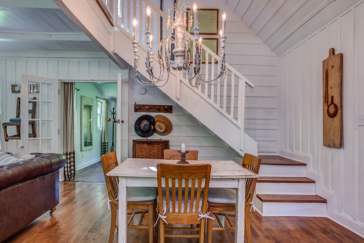 Beautiful farmhouse white staircase at The Nest in Leiper's Fork | Interior Designer: Kim Leggett