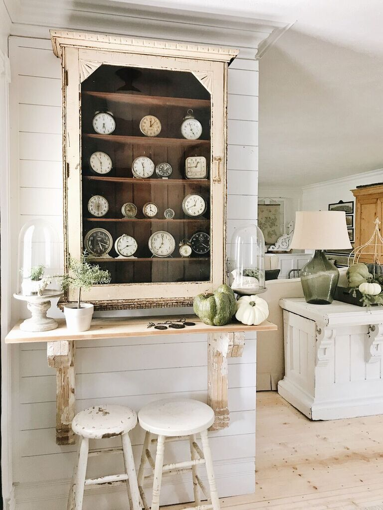 Farmhouse whites fill this living space on the Liz Marie Blog