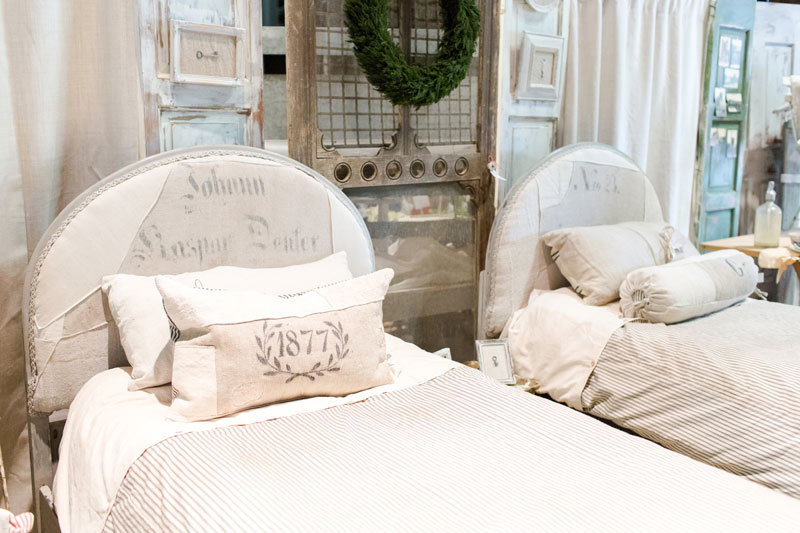 Antique upholstered twin beds at the City Farmhouse Pop Up Fair
