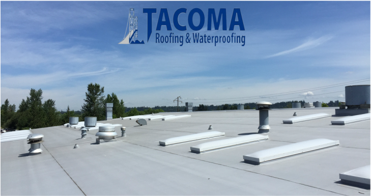 Commercial Roofing Project in Auburn, WA. We installed a brand new single ply TPO roofing system and 57 custom TAM skylights for Adesa Seattle shop.