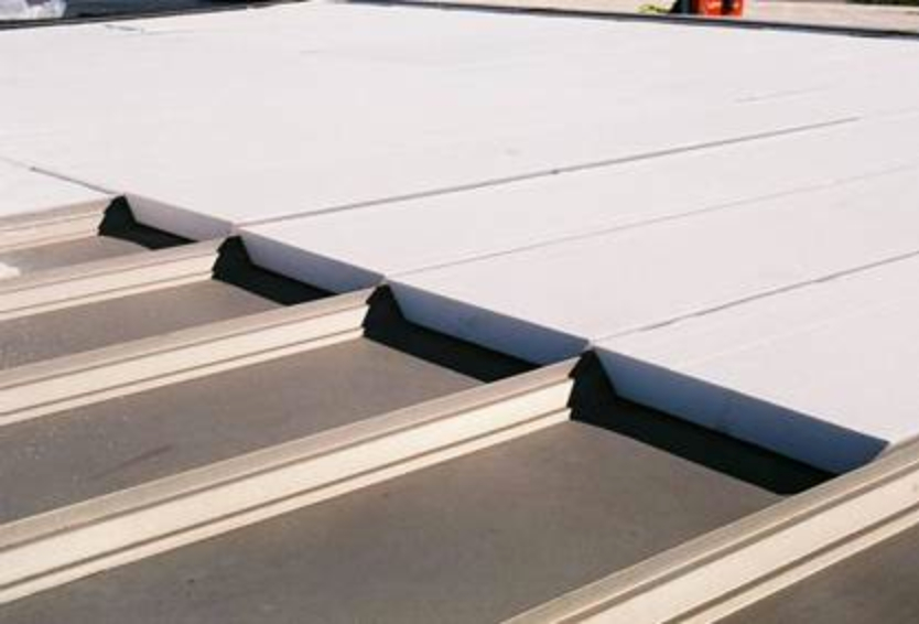 EPS flute filler by Insulfoam is used fill the cavity of the metal roofing panels.