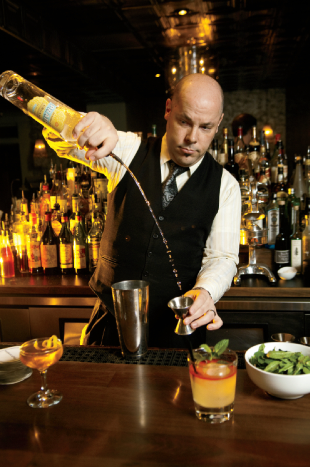 The Patterson House bartender crafting an artisanal cocktail.png