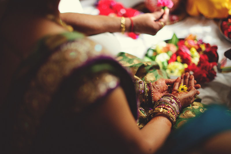 mandap ceremony flowers hands