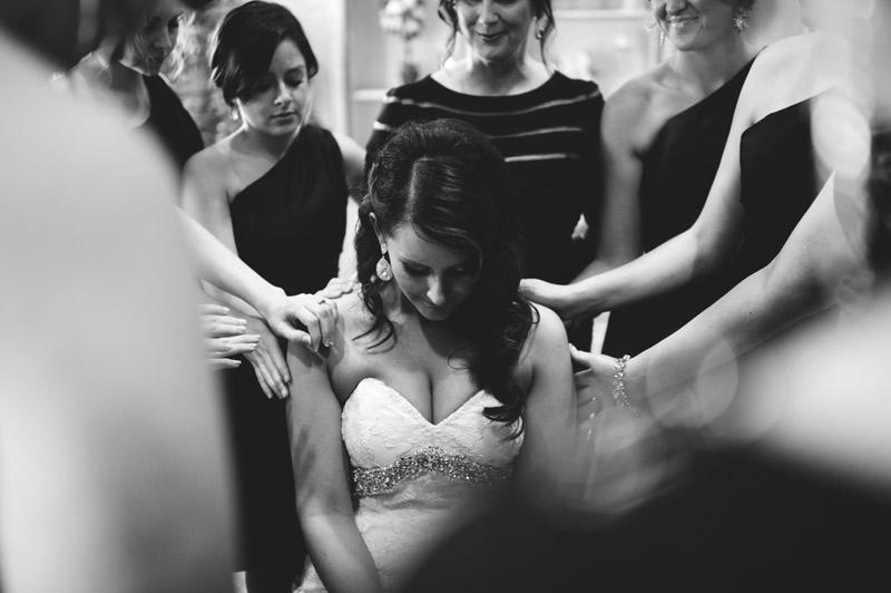 lakewood ranch wedding: bridesmaids praying over bride