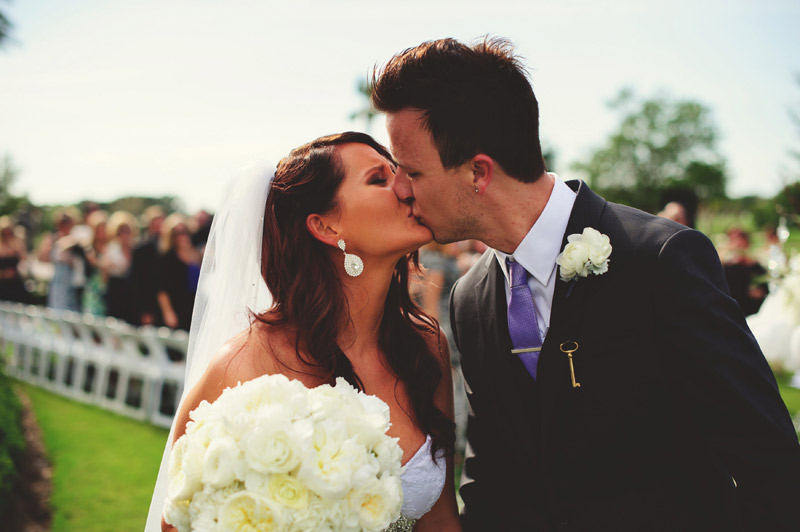 lakewood ranch wedding: bride and groom kissing coming down the aisle